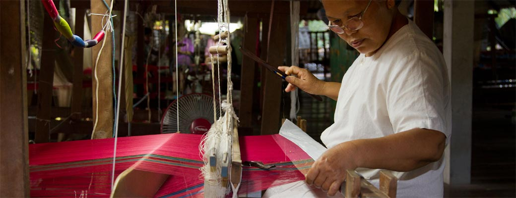 Hand weaving the silk into cloth